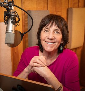 Photo for woman in recording booth
